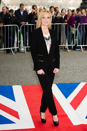 Amanda Holden looked sharp in a tuxedo-inspired suit by Maya.