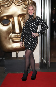 Heidi Range covered her legs with black tights at the British Academy Awards.