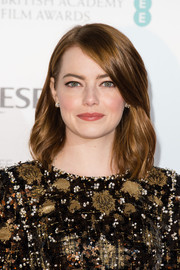 Emma Stone styled her hair with barely-there waves for the BAFTA nominees party.