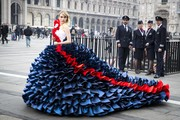 Suki Waterhouse made jaws drop with this mega-ruffled red, white, and blue gown by Zoe Bradley while doing a British Airways photo shoot in Milan. The most amazing part was the gown was actually made out of paper!