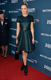 Suki Waterhouse contrasted her feminine dress with edgy black platform boots.