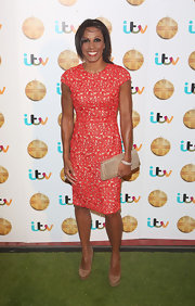 Kelly Holmes showed off her toned arms with this red lace, capped-sleeve dress.