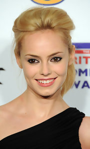 Hannah Tointon wore her hair in a tousled high ponytail with backcombed bangs at the 2011 British Comedy Awards.