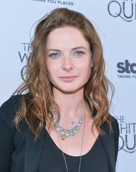 Rebecca styled her hair into romantic waves to soften up her boyish red carpet look.