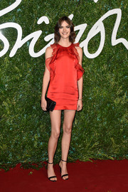 Sam Rollinson flaunted her long, slim pins in a red ruffle mini dress by Topshop during the British Fashion Awards.