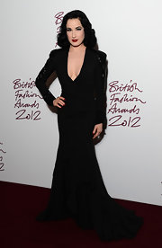 Dita rocked channeled Morticia Addams in the sexiest way possible at the British Fashion Awards.