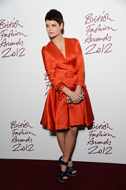 Pixie Geldof showed off her new 'do in a fab retro-inspired taffeta red dress at the British Fashion Awards.