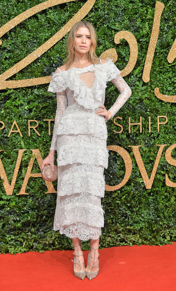 Elena Perminova chose a frothy white lace dress by Alessandra Rich, featuring an ultra-girly mix of ruffles and tiers, for her British Fashion Awards look.