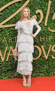 Elena Perminova paired her dress with strappy glitter pumps.