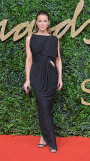 Kate Beckinsale looked like a Grecian goddess gone modern in this draped black Vionnet gown with a hip cutout during the British Fashion Awards.