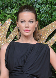 Kate Beckinsale stuck to her signature wavy ponytail when she attended the British Fashion Awards.