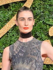 Erin O'Connor wore her hair with a tightly braided top and slicked-back sides during the British Fashion Awards.