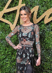 Cheryl Fernandez-Versini paired a black patent clutch with a sheer sequin dress for the British Fashion Awards.