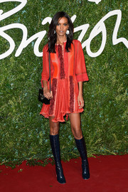 Liya Kebede went the boho route with this red-orange Louis Vuitton tunic dress at the British Fashion Awards.