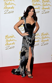 Kelly Brook donned seriously sexy black strappy Jimmy Choo heels. She paired the fabulous crystal embellished heels with a corset dress.