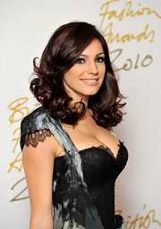 Kelly Brook showed off her radiant curls while attending the British Fashion Awards.