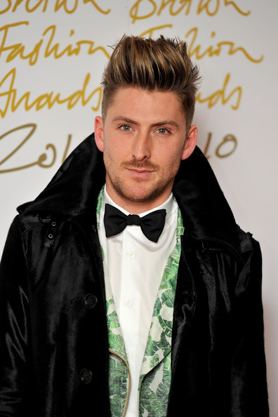 Henry Holland paired his cool trench coat with a classic bowtie.
