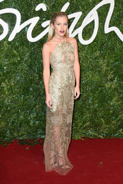 Mollie King radiated in a gold Patricia Bonaldi lace gown with sexy sheer inserts during the British Fashion Awards.