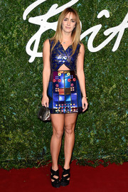 Alexia Niedzielski sported a cool mix of patterns and colors with this cutout mini dress at the British Fashion Awards.