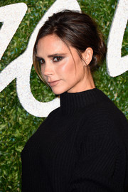 Victoria Beckham kept it laid-back with this loose bun at the British Fashion Awards.