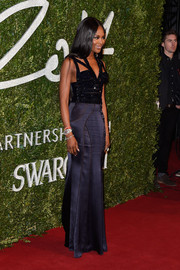 Naomi Campbell was bondage-glam at the British Fashion Awards in an Alexander McQueen gown with a sparkly, strappy bodice.