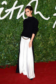 Victoria Beckham completed her outfit with a chain-embellished black-and-white maxi skirt, also from her own collection.
