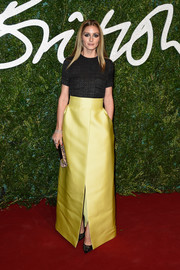 Olivia Palermo hit the British Fashion Awards red carpet wearing a textured black blouse by Emilia Wickstead.