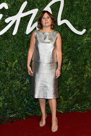 Alexandra Shulman continued the silver motif with a pair of chic strappy sandals.
