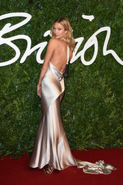 Karlie Kloss sheathed her supermodel figure in a floor-sweeping satin halter gown by Nicholas Oakwell Couture for the British Fashion Awards.