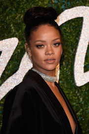Rihanna swept her hair up into a top knot for the British Fashion Awards.