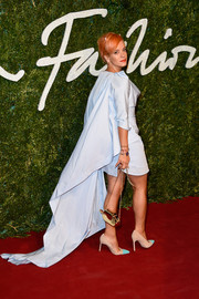 Lily Allen attended the British Fashion Awards wearing a pastel-blue Vivienne Westwood dress, made more dramatic with the addition of a flowing cape.