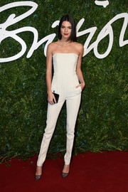 Kendall Jenner looked impossibly slim in a strapless white Emilio Pucci jumpsuit during the British Fashion Awards.