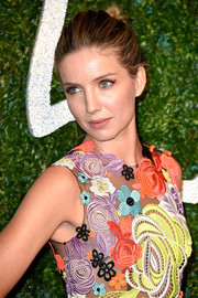 Annabelle Wallis attended the British Fashion Awards wearing her hair in a casual-chic twisted bun.
