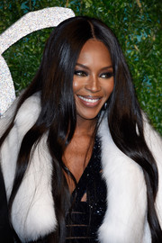 Naomi Campbell wore flowing center-parted tresses during the British Fashion Awards.