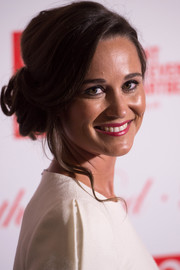 Pippa Middleton looked romantic wearing this loose side bun at the Roll Out the Red Ball.
