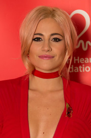 Pixie Lott rocks the cat eye trend with black liner and full lashes.