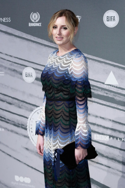 Laura Carmichael arrived for the British Independent Film Awards carrying a beribboned velvet clutch.