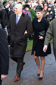 Zara Phillips embodied simple elegance in her navy evening coat.