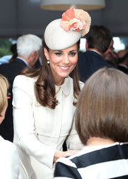 Kate Middleton paired a very ladylike cream and coral Jane Taylor hat with a white coat dress for a World War I commemoration event.