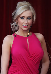 Actress Gemma Merna should off her loose bun while walking the red carpet at the British Soap Awards.
