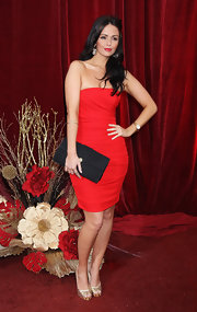 Jennifer Metcalfe looked too hot to trout in her little red dress. She paired her sultry look with a simple envelope clutch.