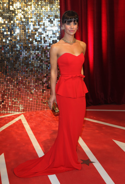 Jessica Fox looked sweet and elegant at the British Soap Awards in a bow-adorned red strapless dress with a peplum waist.