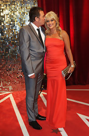 Christie Goddard chose a bright orange strapless dress for her British Soap Awards red carpet look.
