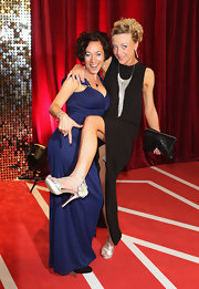 Kelli Hollis complemented her gown with a sequined black clutch when she attended the British Soap Awards.