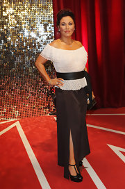 Jessie Wallace paired a textured white off-the-shoulder top with black wide-leg pants for her British Soap Awards red carpet look.