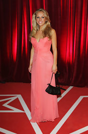 Sophie Abelson looked captivating in a coral strapless gown with a gathered bodice at the British Soap Awards.