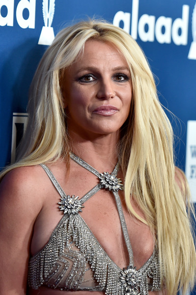 Britney Spears Layered Cut [hair,blond,hairstyle,surfer hair,long hair,chest,muscle,brown hair,model,layered hair,arrivals,britney spears,glaad media awards,honoree,beverly hills,california,the beverly hilton hotel]