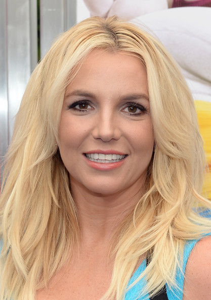 Britney Spears Pink Lipstick [smurfs 2,hair,face,blond,hairstyle,eyebrow,chin,beauty,long hair,lip,layered hair,carpet,britney spears,los angeles,california,regency village theatre,westwood,premiere]