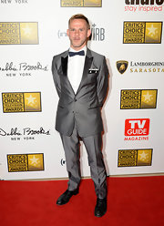 Dominic Monaghan chose a dark charcoal two-button suit with black peak lapels and a dotted bow tie for his look at the Critics' Choice Television Awards.