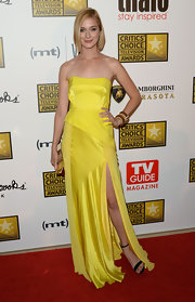 Caitlin Fitzgerald wore this canary yellow strapless dress that featured a thigh-high slit for an added touch of sexiness.